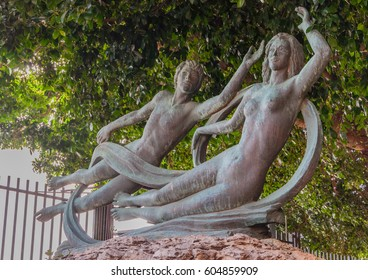 Beautiful bronze statue of Arethusa and Alpheus on the island of Ortygia in Syracuse, Sicily. Arethusa and Alpheus are characters of an ancient greek myth about love.
