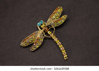 Beautiful brooch in the form of a dragonfly on a black background
