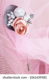 Beautiful brooch on a pink background