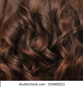Beautiful brown hair. Brown hair background. Brown hair lock closeup.