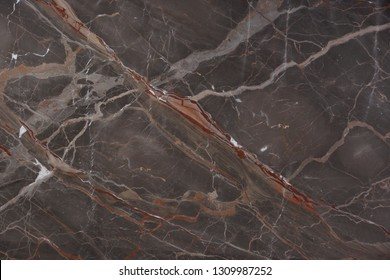 Beautiful brown marble with pink and red veins, called Caravaggio