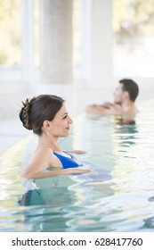 Beautiful brown woman relaxing in thalassotherapy thermal water