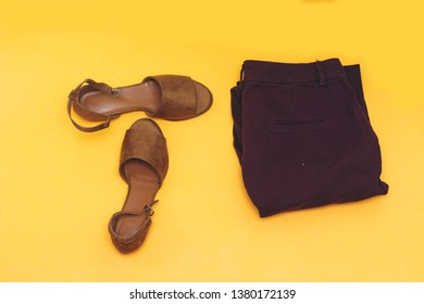 beautiful brown woman summer sundal and pant isolated on yellow background