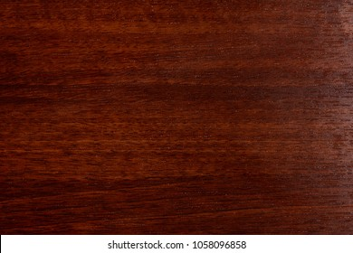 Beautiful brown wood background on lacquered textured plywood