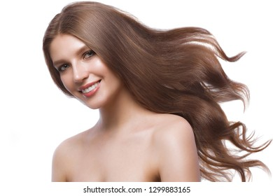 Beautiful brown-haired girl in move with a perfectly curls hair, and classic make-up. Beauty face and hair. Picture taken in the studio on a white background.