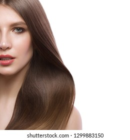 Beautiful brown-haired girl with a perfectly smooth hair, and classic make-up. Beauty face and hair. Picture taken in the studio on a white background.