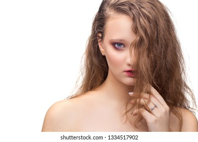 Beautiful brown-haired woman face studio on white. high key portrait