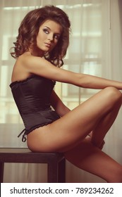 Beautiful brown-haired woman indoors
