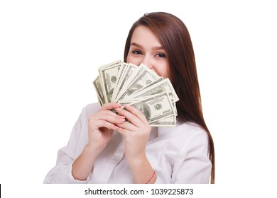 Beautiful brunet with dollars on a white background. Young business woman showing money on cam