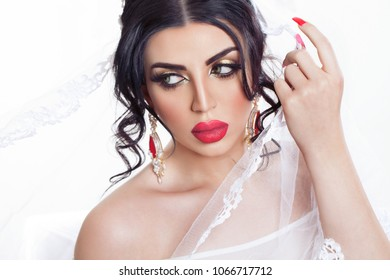 Beautiful brunette  Arab bride in a wedding dress and a crown on her head. Beauty face.