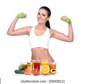 Beautiful Brunette athlete holding dumbbells. It should be at the table with fruit and juice isolated on white background.