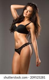 Beautiful brunette beauty in black underwear