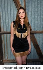 Beautiful brunette in black Western dress