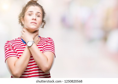 Beautiful brunette curly hair young girl wearing casual look over isolated background shouting and suffocate because painful strangle. Health problem. Asphyxiate and suicide concept.