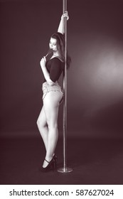 Beautiful brunette dancing on a pole