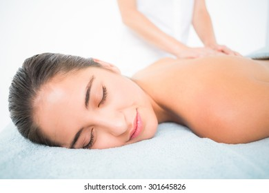 Beautiful brunette enjoying a massage at the health spa