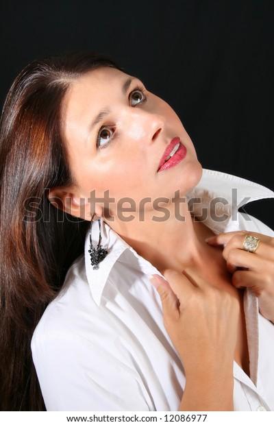 Beautiful brunette female model against a dark background