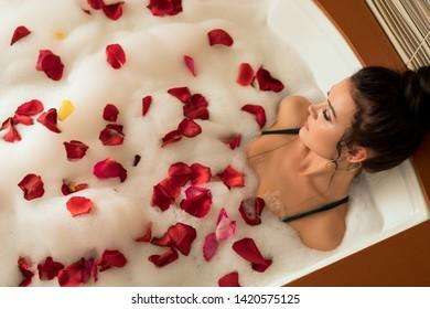 Beautiful brunette in foam bath