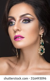 Beautiful brunette girl with arabic evening make-up and perfect skin. Beauty face.