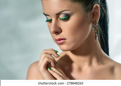 Beautiful Brunette Girl. Beauty Model Woman with Green makeup.