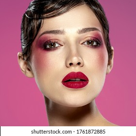 Beautiful brunette girl with bright eye makeup. Beautiful fashion woman with  a cherry lipstick on her lips. Glamour fashion model with vivid make-up. Stylish fashionable concept. Art. Beauty  face.