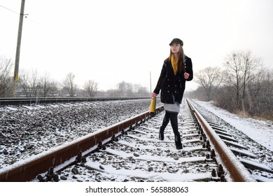 beautiful brunette girl comes by rail in winter