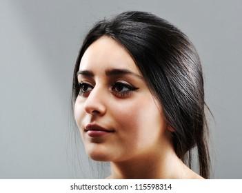Beautiful brunette girl face profile