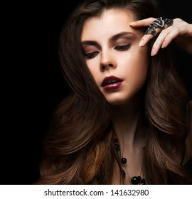 Beautiful Brunette Girl. Healthy Long Hair and Holiday Makeup. Jewelry.