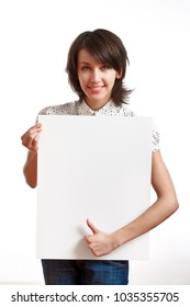 beautiful brunette girl holding an empty white board and smiling