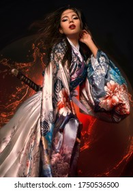 beautiful brunette girl in a kimono. model in asian clothes. geisha