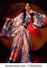 beautiful brunette girl in a kimono. model in asian clothes. geisha
