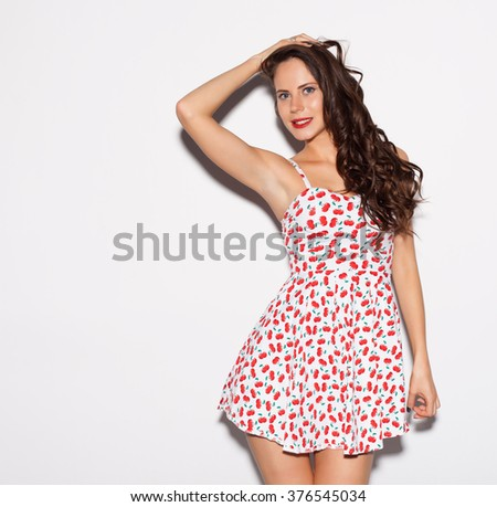 e52a1ca304d Beautiful brunette girl with long hair and blue eyes posing in bright summer  short dress nex