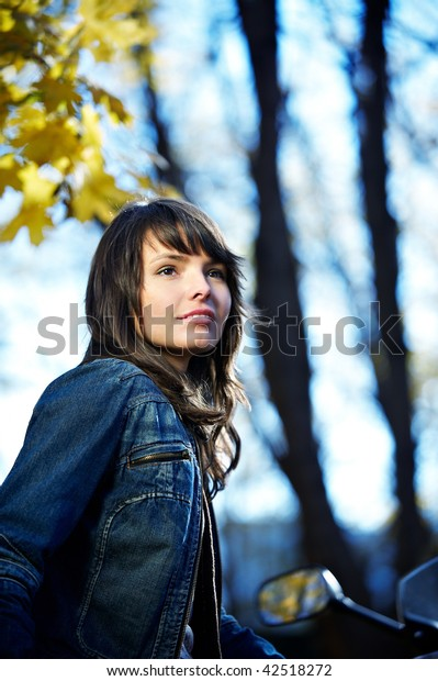 The beautiful brunette girl on the park