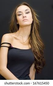 Beautiful Brunette Girl over black background
