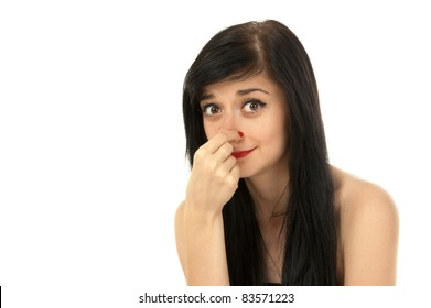 Beautiful brunette girl pinching her nose on white background close-up