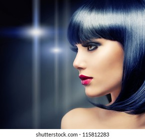 Beautiful Brunette Girl Portrait over Dark Background. Healthy Black Hair