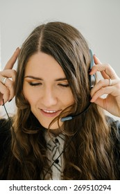 beautiful brunette girl talking on headphones with microphone