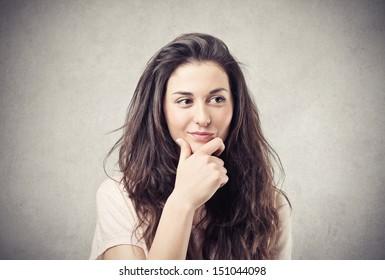 beautiful brunette girl thinks