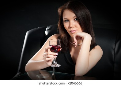 Beautiful brunette with a glass of red wine