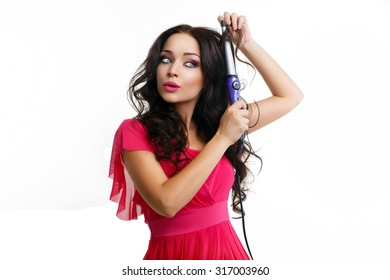 Beautiful brunette with hair curlers