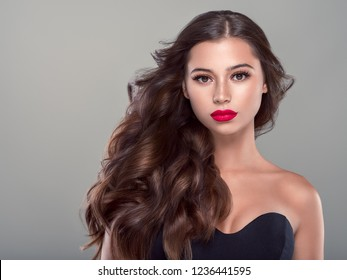 Beautiful brunette hair woman with beauty makeup long hairstyle