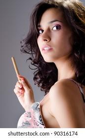 Beautiful brunette having an arrogant expression