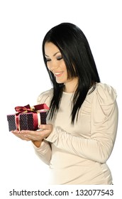 Beautiful brunette holding a present box against white background