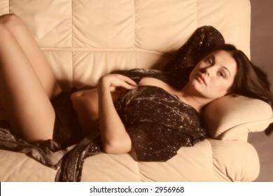Beautiful brunette laying on sofa