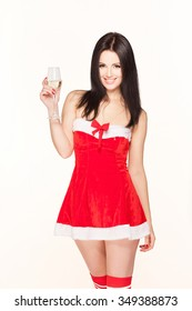 Beautiful brunette model in a Christmas suit with a glass of champagne