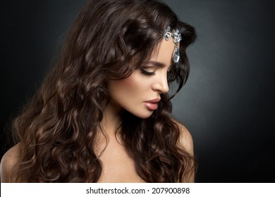 Beautiful brunette model with long curly brown hair. Gems.