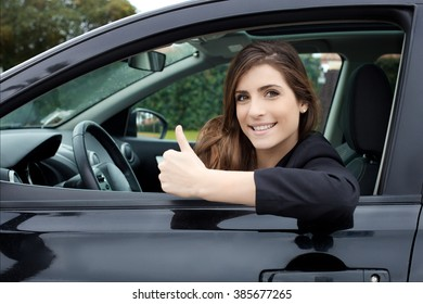 beautiful brunette with new car smiling happy