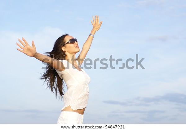 Beautiful brunette over sky background