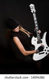 Beautiful brunette playing her electric guitar