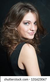Beautiful brunette posed on black background.